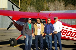 Close up of Jim Moore, Roger Hicks, Joe Bell and Caleb Dardick in front of the plane - Nov 2013