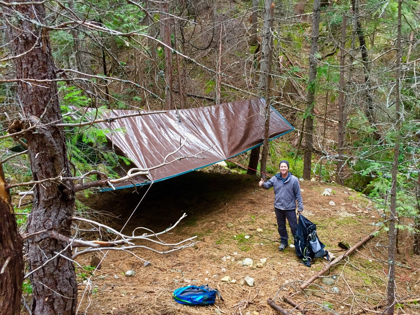 Volunteer Brennan Johnston set up the tarp for the overnight storm sampling on Scotchman Creek